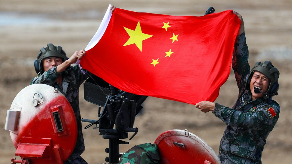 MOSCOW REGION, RUSSIA - AUGUST 28, 2021: People's Liberation Army (PLA) soldiers pose with a Chinese flag on a TYPE 96B tank during the Tank Biathlon Contest at the 2021 International Army Games at a military training ground in Alabino, Moscow Region. This year, 19 teams which are divided into two divisions, are competing in the contest.