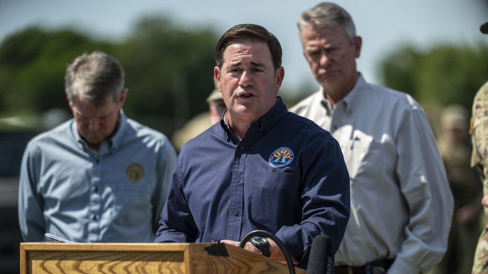 Doug Ducey, governor of Arizona, speaks during a news conference in Mission, Texas, U.S., on Wednesday, Oct. 6, 2021. Texas Governor Abbott and Republican state chief executives from around the nation gathered at the border to again call attention to unauthorized immigration across the Rio Grande. Photographer: Sergio Flores/Bloomberg