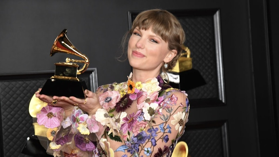 63rd Annual GRAMMY Awards – Media Room LOS ANGELES, CALIFORNIA - MARCH 14: Taylor Swift, winner of Album of the Year for 'Folklore', poses in the media room during the 63rd Annual GRAMMY Awards at Los Angeles Convention Center on March 14, 2021 in Los Angeles, California. (Photo by Kevin Mazur/Getty Images for The Recording Academy ) Kevin Mazur / Contributor