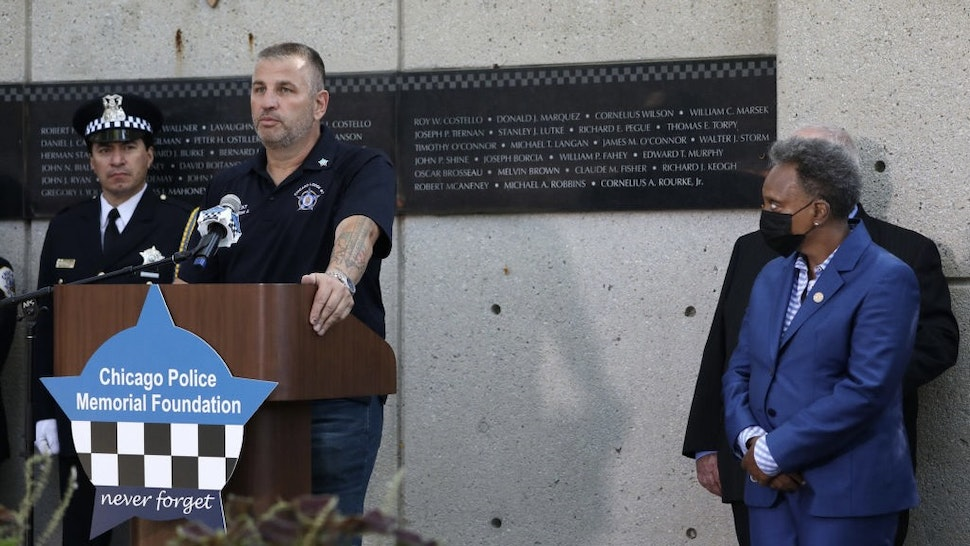 US-NEWS-CORONAVIRUS-CHICAGO-POLICE-TB John Catanzara, president of the Chicago Fraternal Order of Police Lodge 7, addresses attendees as Mayor Lori Lightfoot watches during the unveiling of names for five Chicago police officers at the Gold Star Families Memorial and Park in September. Four of the officers died of COVID-19 symptoms in 2020, and Officer Ella French was fatally shot on Aug. 7, during a traffic stop while on patrol. (John J. Kim/Chicago Tribune/Tribune News Service via Getty Images) Chicago Tribune / Contributor