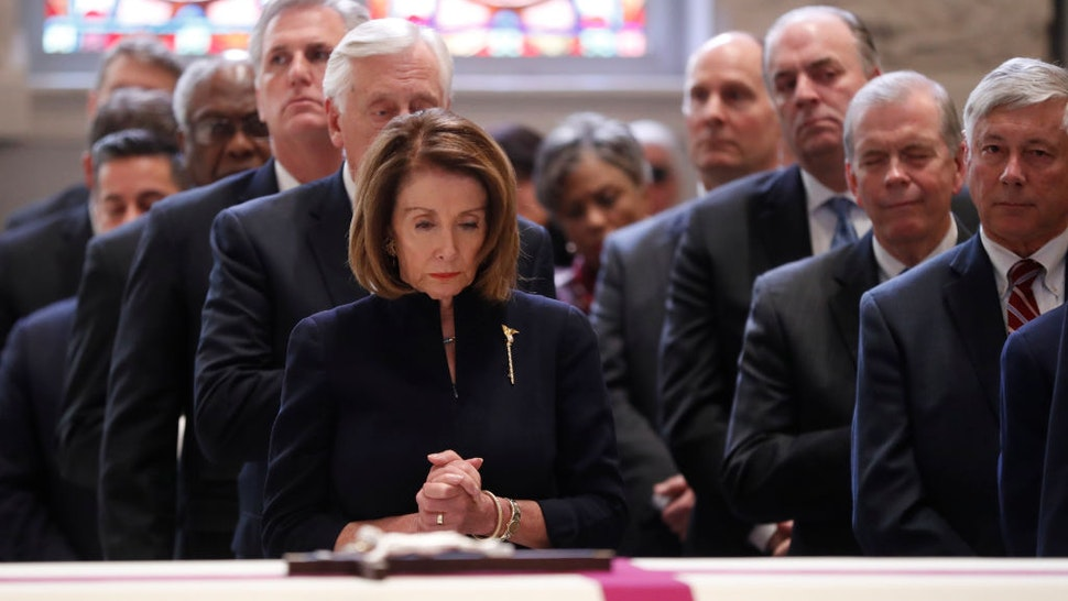 WASHINGTON, DC - FEBRUARY 14: House Speaker Nancy Pelosi stands during funeral services for former Rep. John Dingell on February 14, 2019 at Holy Trinity Catholic Church in Washington, DC. Dingell, who represented southeast Michigan for 59 years in the House of Representatives, died last week at age 92. (Photo by Pablo Martinez Monsivais - Pool/Getty Images)