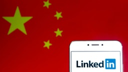 HONG KONG - 2019/04/06: In this photo illustration a business and employment oriented network and platform LinkedIn logo is seen on an Android mobile device with People's Republic of China flag in the background.