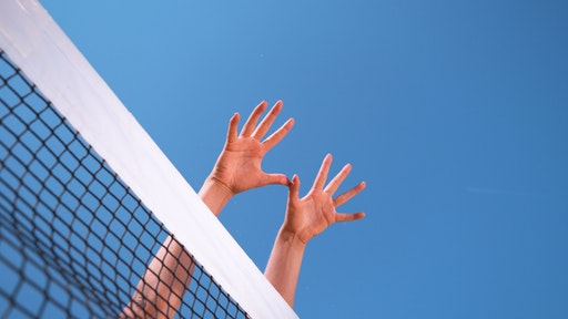 woman spiking volleyball