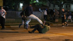 A protester clashes with armed civilian Kyle Rittenhouse during confrontations between protesters and armed civilians, who claimed to protect the streets of Kenosha against the arson, during the third day of protests over the shooting of a black man Jacob Blake by police officer in Wisconsin, United States on August 25, 2020.