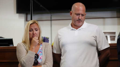 Tara Petito (L) and Joe Petito react while the City of North Port Chief of Police Todd Garrison speaks during a news conference for their missing daughter Gabby Petito on September 16, 2021 in North Port, Florida.