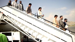 Passengers disembark from a plane at Kabul International Airport in Kabul, capital of Afghanistan, Sept. 20, 2021.