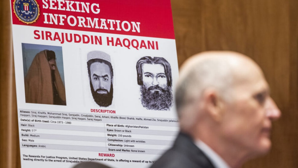 An FBI Most Wanted poster of Sirajuddin Haqqani, leader of the Haqqani Network, during a Senate Homeland Security Committee hearing in Washington, D.C., U.S., on Tuesday, Sept. 21, 2021. The Department of Homeland Security is investigating a heated confrontation between border patrol agents on horseback and Haitian migrants seeking asylum in the U.S.