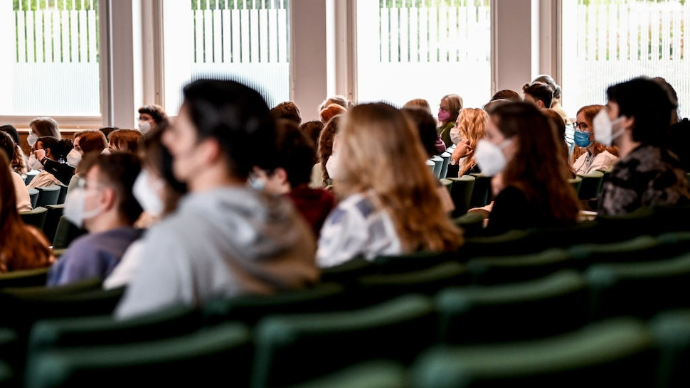 Students sitting in the Audimax of Freie Universität Berlin. Freie Universität Berlin is celebrating the start of the 2021/2022 winter semester, which is to be held with a large proportion of face-to-face events, with an action week.