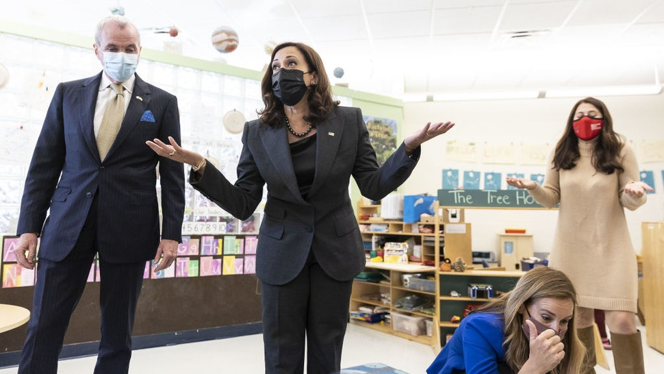 Phil Murphy, New Jersey's governor, left, and U.S. Vice President Kamala Harris speak with children at Ben Samuels Childrens Center at Montclair State University in Little Falls, New Jersey, U.S., on Friday, Oct. 8, 2021.
