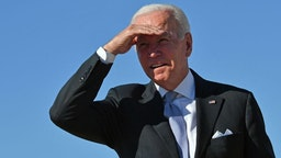 US President Joe Biden block the sun with his hand as he boards Air Force One at Andrews Air Force Base in Maryland on October 20, 2021.
