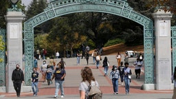 Students walk near the Sather Gate on the UC Berkeley campus in Berkeley, Calif., on Tuesday, August 24, 2021.