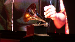 CHICAGO, ILLINOIS - SEPTEMBER 16: A view of a Grammy statue during a performance at the Chicago Chapter 60th Anniversary Concert at Millennium Park on September 16, 2021 in Chicago, Illinois. (Photo by Jeff Schear/Getty Images for The Recording Academy)