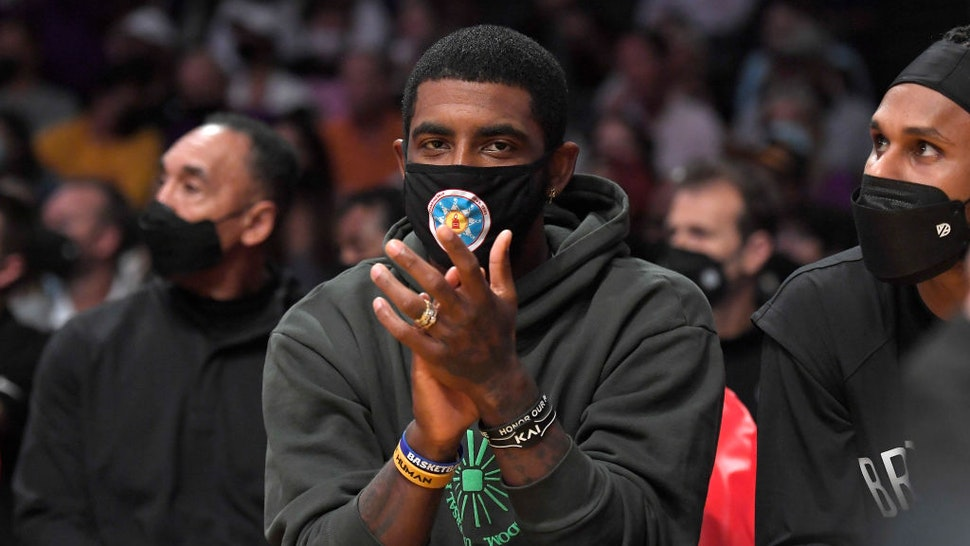 LOS ANGELES, CA - OCTOBER 03: Kyrie Irving #11 of the Brooklyn Nets cheers from the bench during a preseason game against the Los Angeles Lakers at Staples Center on October 3, 2021 in Los Angeles, California. NOTE TO USER: User expressly acknowledges and agrees that, by downloading and/or using this Photograph, user is consenting to the terms and conditions of the Getty Images License Agreement. (Photo by Kevork Djansezian/Getty Images)