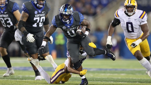 LEXINGTON, KENTUCKY - OCTOBER 09: Kavosiey Smoke #0 of the Kentucky Wildcats runs with the ball against the LSU Tigers at Kroger Field on October 09, 2021 in Lexington, Kentucky. (Photo by Andy Lyons/Getty Images)