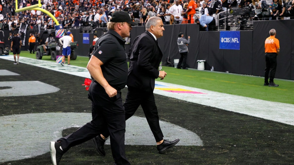 LAS VEGAS, NEVADA - OCTOBER 10: Head coach Jon Gruden (L) of the Las Vegas Raiders and Raiders director of team security Bob Stiriti run off the field after the team's 20-9 loss to the Chicago Bears at Allegiant Stadium on October 10, 2021 in Las Vegas, Nevada. (Photo by Ethan Miller/Getty Images)