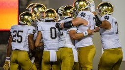 BLACKSBURG, VA - OCTOBER 09: Notre Dame Fighting Irish players celebrate after a touchdown against the Virginia Tech Hokies during the first half of the game at Lane Stadium on October 9, 2021 in Blacksburg, Virginia. (Photo by Scott Taetsch/Getty Images)