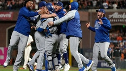 SAN FRANCISCO, CALIFORNIA - OCTOBER 14: The Los Angeles Dodgers celebrate after beating the San Francisco Giants 2-1 in game 5 of the National League Division Series at Oracle Park on October 14, 2021 in San Francisco, California. (Photo by Thearon W. Henderson/Getty Images)