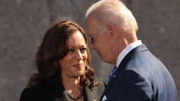 U.S. President Joe Biden (R) and Vice President Kamala Harris shake hands during the 10th-anniversary celebration of the Martin Luther King, Jr. Memorial near the Tidal Basin on the National Mall on October 21, 2021 in Washington, DC.