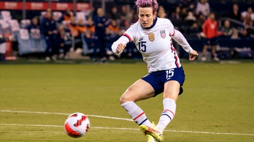 KANSAS CITY, KS - OCTOBER 21: Megan Rapinoe #15 of United States takes a shot at the Korea Republic goal during the first half of the International Friendly match at Children's Mercy Park on October 21, 2021 in Kansas City, Kansas. (Photo by Kyle Rivas/Getty Images)