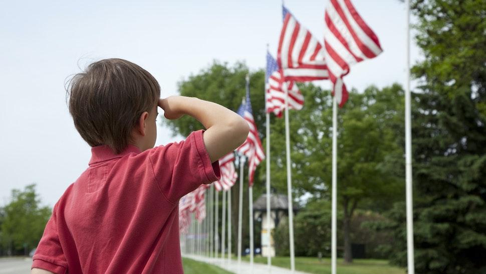 Boy saluting US flag