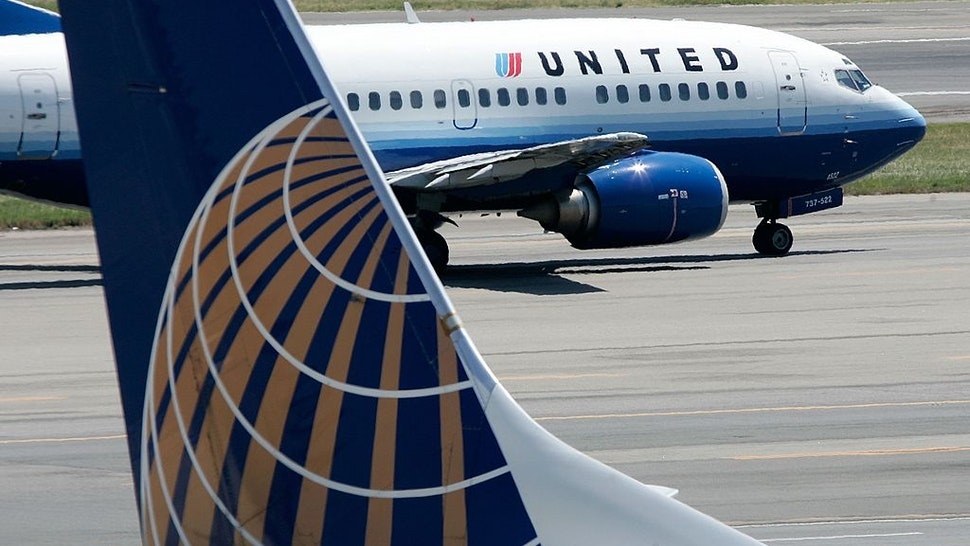 United Can't Put Workers With COVID Vaccine Exemption On Unpaid Leave, Judge Says