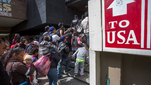 migrants at the southern U.S. border to stay in Mexico