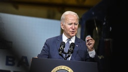 U.S. President Joe Biden speaks at the NJ Transit Meadowlands Maintenance Complex in Kearny, New Jersey, U.S., on Monday, Oct. 25, 2021. Bidenwill argue that his economic agenda will ease rail congestion in the Northeast Corridor during a trip to the state today that will put him alongside New Jersey GovernorPhil Murphyahead of next week's election.Photographer: Stephanie Keith/Bloomberg