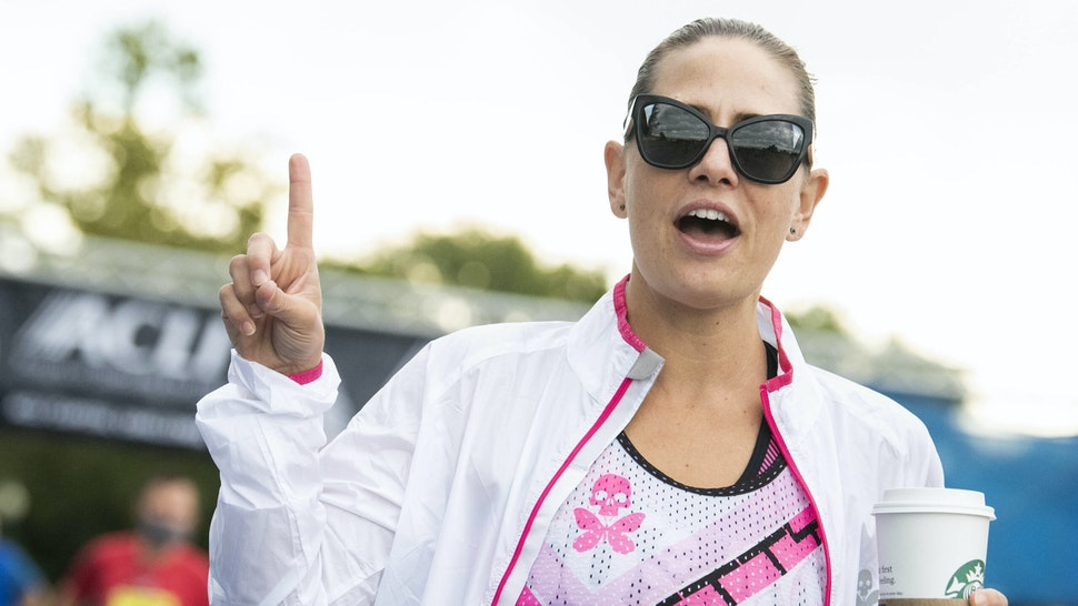 UNITED STATES - SEPTEMBER 29: Sen. Kyrsten Sinema, D-Ariz., walks the ACLI Capital Challenge 3 Mile Team Race in Anacostia Park on Wednesday, September 29, 2021. Sinema has been rehabbing her right foot.