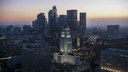 Aerial view of Los Angeles City Hall with crowded cityscape at sunset, Los Angeles, California, USA.
