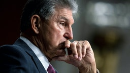 WASHINGTON, DC - SEPTEMBER 28: Sen. Joe Manchin (D-WV) pauses during a Senate Armed Services Committee hearing on the conclusion of military operations in Afghanistan and plans for future counterterrorism operations at the Dirksen Senate Office building on Capitol Hill on September 28, 2021 in Washington, DC.