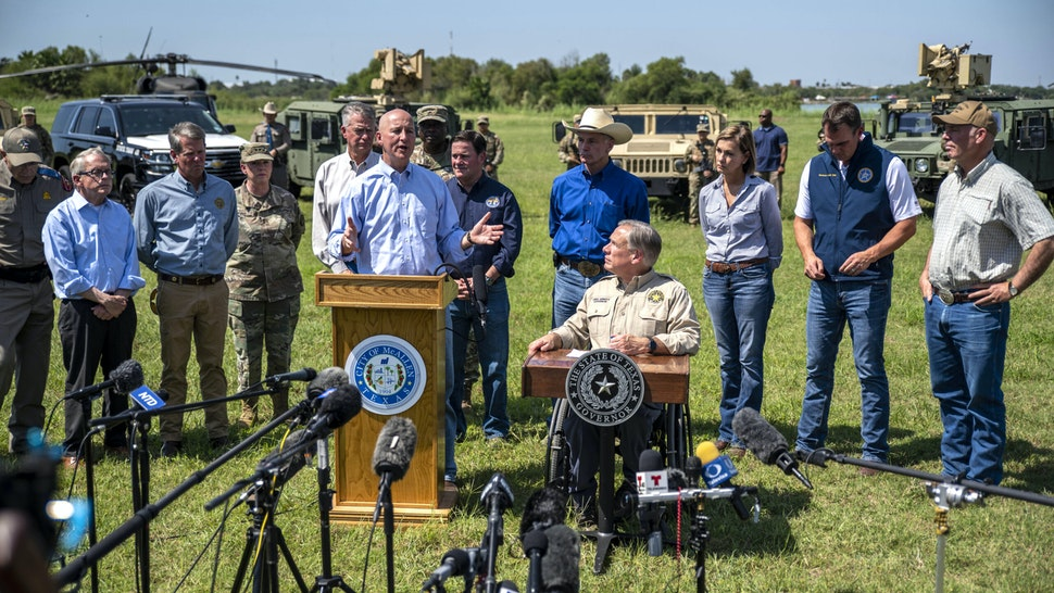 Pete Ricketts, governor of Nebraska, speaks beside Greg Abbott, governor of Texas, center right, during a news conference in Mission, Texas, U.S., on Wednesday, Oct. 6, 2021. Abbott and Republican state chief executives from around the nation gathered at the border to again call attention to unauthorized immigration across the Rio Grande.