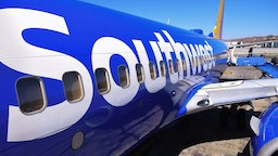 Passengers deplane from a Southwest Airlines flight from Las Vegas at Hollywood Burbank Airport in Burbank, California, October 10, 2021. - Southwest Airlines canceled hundreds of flights over the weekend, blaming the cancellations on poor weather and air traffic control issues.