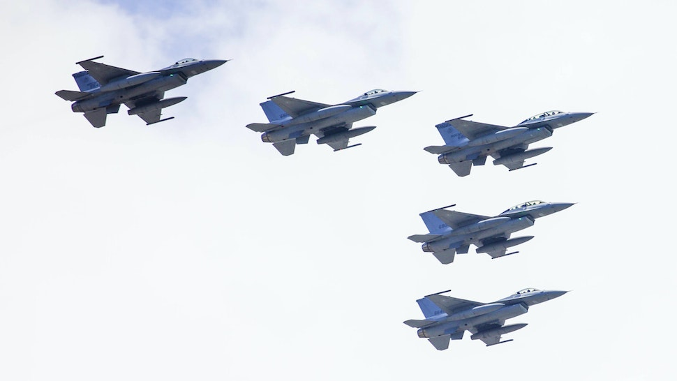 F-16V jets, manufactured by Lockheed Martin Corp., fly over the city during the National Day celebration in Taipei, Taiwan, on Sunday, Oct. 10, 2021. Taiwan PresidentTsai Ing-Wensaid the island is facing unprecedented challenges and will defend its sovereignty, pushing back after Chinese leaderXi Jinpingdeclared a day earlier that unification will be achieved.