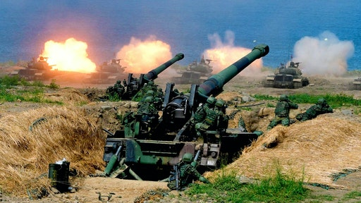 """US-made CM-11 tanks (in background) are fired in front of two 8-inch self-propelled artillery guns during the 35th """"Han Kuang"""" (Han Glory) military drill in southern Taiwan's Pingtung county on May 30, 2019. - The manoeuvres in Taiwan come after the US, Japan, South Korea and Australia kicked off operation """"Pacific Vanguard"""" near Guam, bringing together more than 3,000 sailors from the four countries last week."""