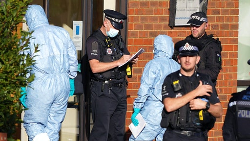 Forensic officers at the scene near the Belfairs Methodist Church in Eastwood Road North, Leigh-on-Sea, Essex, where Conservative MP Sir David Amess has died after he was stabbed several times at a constituency surgery. A man has been arrested and officers are not looking for anyone else. Picture date: Friday October 15, 2021.