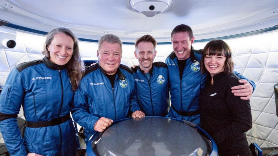 The crew of NS-18, Audrey Powers, William Shatner, Dr. Chris Boshuizen, and Glen de Vries, with CrewMember 7 Sarah Knights (October 12, 2021)