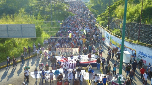 TAPACHULA, CHIAPAS, MEXICO - OCTOBER 22: Migrant caravan made up of approximately 3,000 people, called March for Freedom, Dignity and La Paz, managed to break the first police siege of the National Institute of Migration, National Guard and State Police that he was on the outskirts of Tapachula, Chiapas in Mexico on October 22, 2021. They continue on their way to Mexico City.